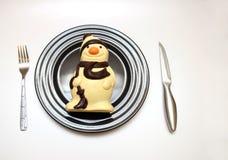 Comendo o boneco de neve Imagens de Stock