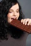 Comendo o chocolate Fotografia de Stock Royalty Free