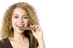 Comendo o chocolate Imagens de Stock Royalty Free
