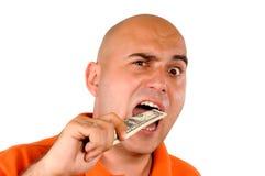 Comendo o dinheiro Fotografia de Stock Royalty Free
