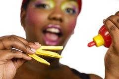 Comendo o fast food fotografia de stock royalty free