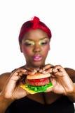 Comendo o fast food fotografia de stock
