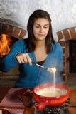 Comendo o fondue fotos de stock royalty free