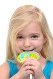 Comendo o Lollipop Imagem de Stock