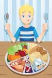 Comendo o menino Imagens de Stock