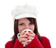 Comendo um copo do chá morno Imagem de Stock
