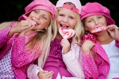 Comendo um lollipop Foto de Stock
