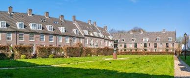Comenius courtyard in Naarden, Netherlands. Courtyard with rows of houses behind Comenius Museum in old town of Naarden, North Holland, Netherlands stock image