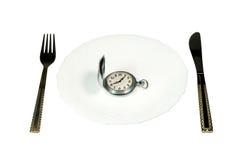 Comer acima do tempo fotografia de stock