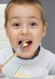 Comer da criança imagem de stock