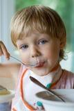 Comer da criança Foto de Stock Royalty Free
