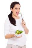 Comer da jovem mulher fotografia de stock royalty free
