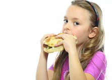 Comer da menina Foto de Stock Royalty Free