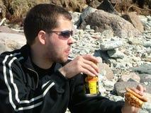 Comer na praia Foto de Stock Royalty Free
