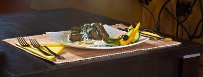 Comer no restaurante Imagens de Stock