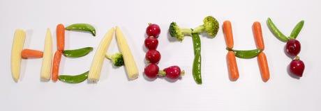 Comer saudável escrito em Veg fresco Imagem de Stock Royalty Free