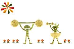 Comer saudável. Pessoas pequenas engraçadas das fatias do quivi. Imagens de Stock Royalty Free