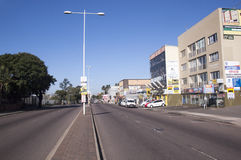 Comercial Buildings and Parked Vehicles Umgeni Road Durban. DURBAN, SOUTH AFRICA - JUNE 19, 2016: Empty early morning Umgeni road heading past comercial Royalty Free Stock Images
