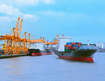 Comercial ship with container on shipping port for import export Royalty Free Stock Image