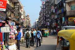 Comercial Street view in Delhi. Crowded street in Delhi, tuk tuks polluted air, busy stress urban Royalty Free Stock Photography