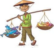 Comerciante asiático con los pescados frescos y las frutas Imagen de archivo libre de regalías