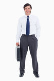 Comerciante de sorriso com sua mala de viagem Imagens de Stock