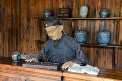 Comerciante de uma casa de chá Fotos de Stock Royalty Free