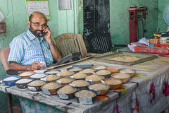 Comerciante del arroz fotografía de archivo libre de regalías