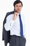 Comerciante novo com o revestimento sobre seu ombro Fotografia de Stock