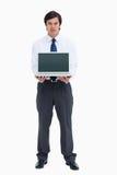 Comerciante que presenta la pantalla de su computadora portátil Imagen de archivo
