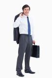 Comerciante sonriente con la chaqueta y la maleta Imagen de archivo libre de regalías