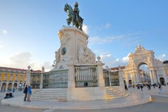 LISBON, PORTUGAL - NOVEMBER 2, 2017: Comercio Square at sunset with the Equestrian statue of King Jose 1 in the foreground and the stock photography