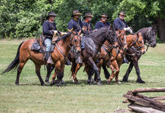 Comes the Cavalry. Civil War era soldiers in battle at the Dog Island reenactment in Red Bluff, California royalty free stock photos