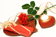 It comes from the heart. Rose with gift ribbon and candle Royalty Free Stock Images