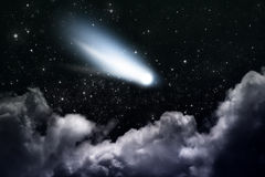 Comet. Cloudy night sky with stars and comet Royalty Free Stock Images