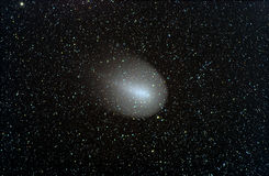 Comet Holmes in 2007. A long exposure photograph of Comet Holmes showing also the different colours of the stars. Image taken on 13th December 2001. This is a Stock Images