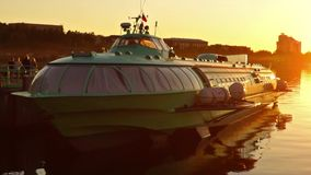 Comet hydrofoil vessel in dock at sunset pan stock footage
