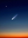 Comet in Night Sky. Clear sky after sunset incorporating illustration of a comet Stock Images