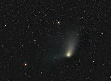 Comet Panstarrs. Astrology astronomy cluster comet constellation cosmos galaxy light moon stock image