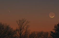 Comet Panstarrs and the Crescent Moon stock image