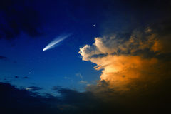 Comet in sky. Scientific background - bright comet in dark blue sky with stars, glowing clouds royalty free stock photography