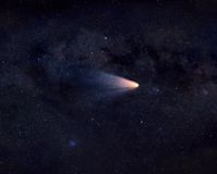 Comet in space. Bright comet with wide tail flying in space Royalty Free Stock Photos