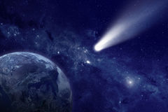 Comet in space. Scientific and astrological background - comet approaches planet earth, space with stars and nebula; mystical sign in sky. Elements of this image Stock Photo