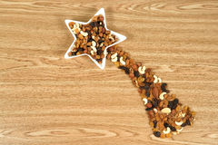 Comet star made of nuts and dried food Royalty Free Stock Photos