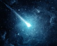Comet in the starry sky. Elements of this image furnished by NASA. Comet in the starry blue sky. Elements of this image furnished by NASA royalty free stock photography