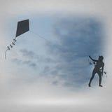 Cometa de la muchacha y del vuelo Foto de archivo