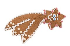 Cometa fatta a mano del pan di zenzero di Natale isolata su un fondo bianco Fotografia Stock