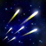 Comets flying through space and starry sky Stock Photos