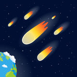Comets, Meteors or Asteroids Falling. Burning comets or meteors or asteroids threatening planet Earth on a dark blue outer space background with bright stars Royalty Free Stock Images