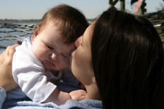 Comfort. Young Mother comforting her baby boy royalty free stock photo